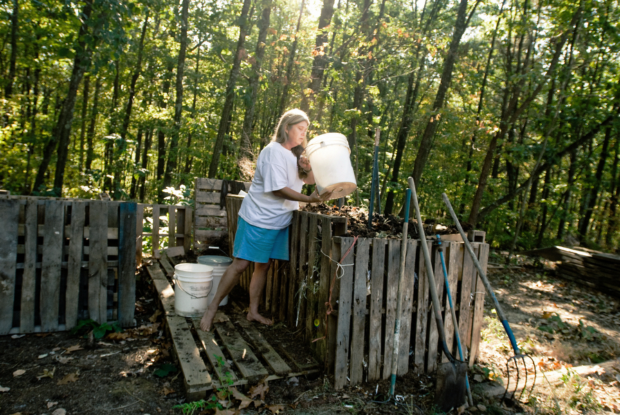 Kathy Jacobsen composting at her home in Broadwell, Ohio